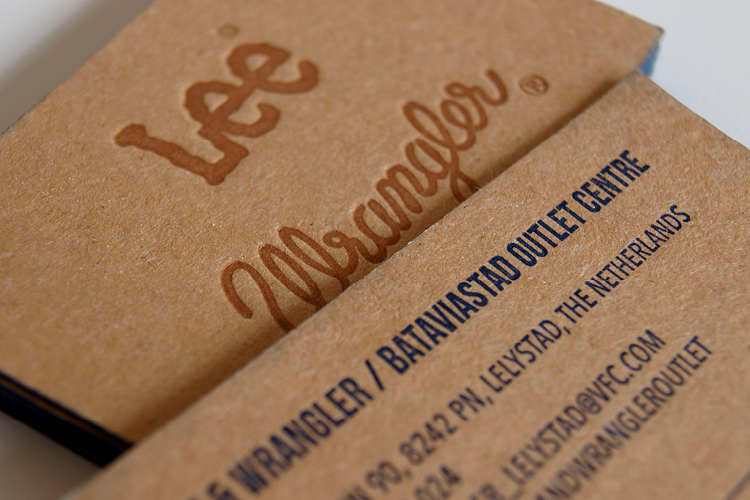 Business cards for Lee and Wrangler outlets For the Lee and Wangler outlet stores, Mieke Fassart (from Vf Europe) and I, came up with some nice ideas for a card design. We managed to highlight both brand identities by bringing the right elements together: The appropriate color, working with a rough cardboard paper and by adding a subtle printing technique.